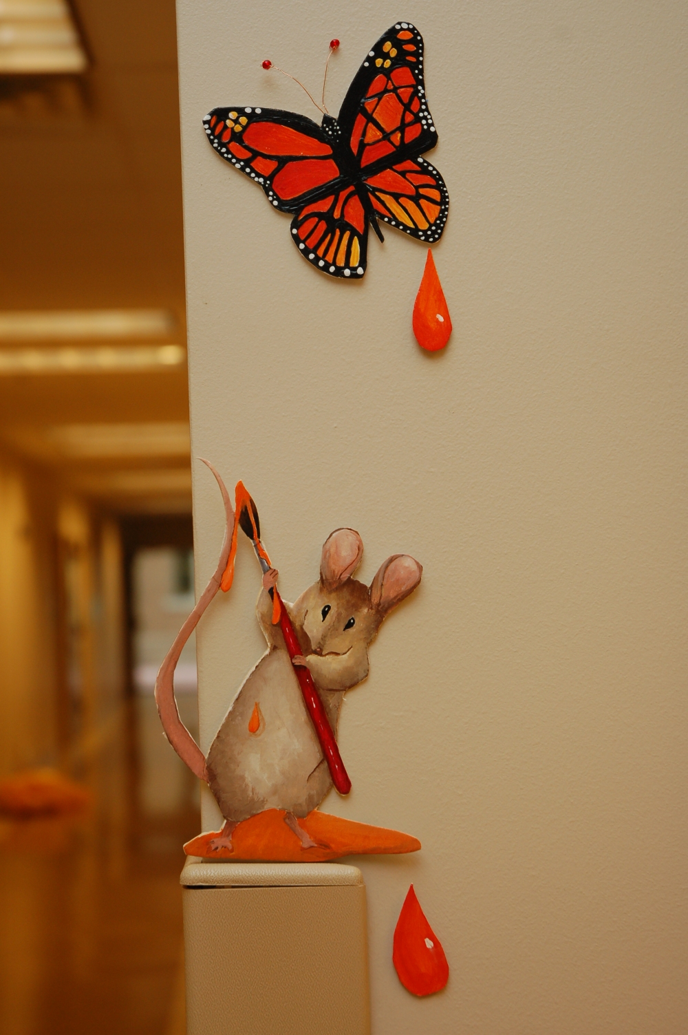 I painted this little mouse & Monarch butterfly for the preschool I worked for.