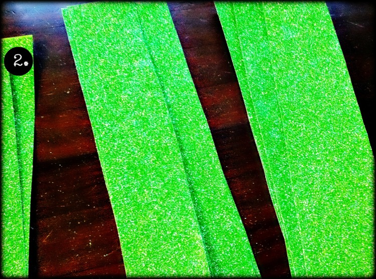 "cut bag at seems. Cut the front & back of bag into strips about 1.5 to 2"" wide."
