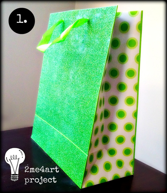 Pick out cool gift bag. (I bought this one for 1.99) new or given to you.  Green glitter outside, green polkadots on the inside…