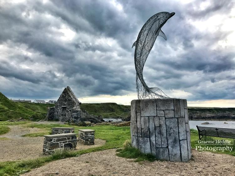Dolphin sculpture at Portsoy, Moray